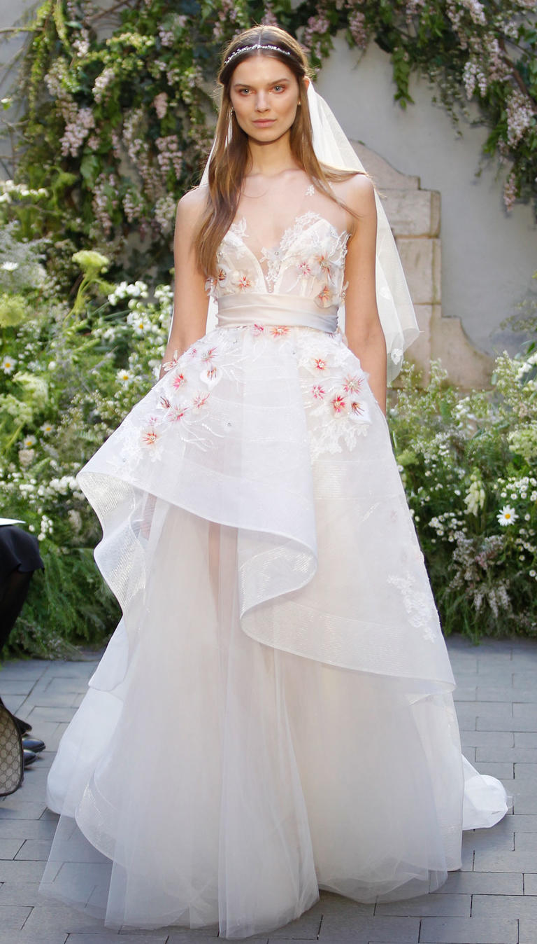 A wedding dress with flowery elements