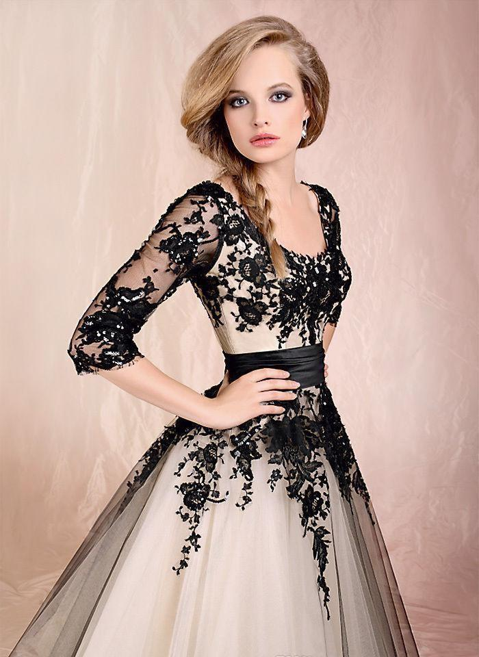 An Ivory Wedding Dress With Black Lace