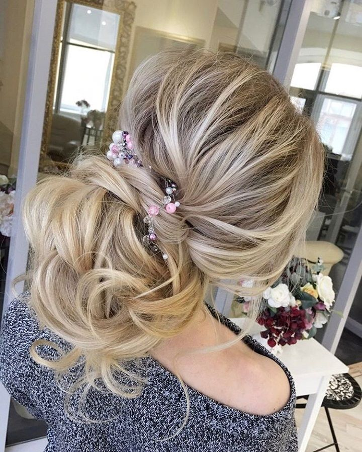 A loose romantic wedding updo
