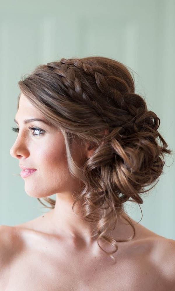 A soft chignon with loose curls