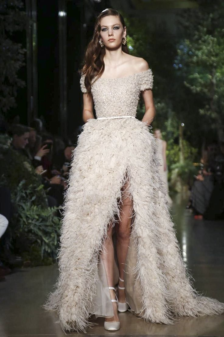 A wedding dress with feathers
