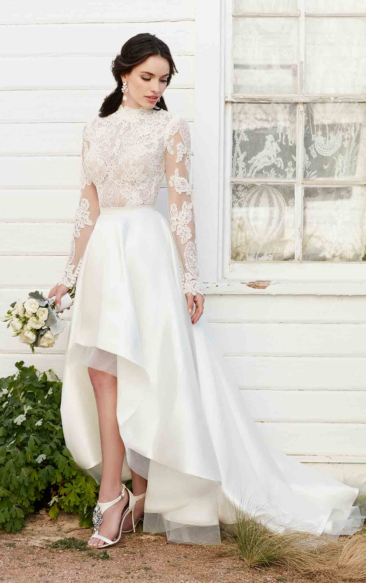 A high low wedding gown with long sleeves