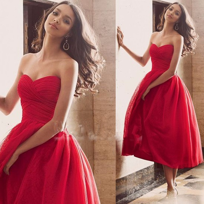 Why do some brides get married using red wedding dresses for Red tea length wedding dress