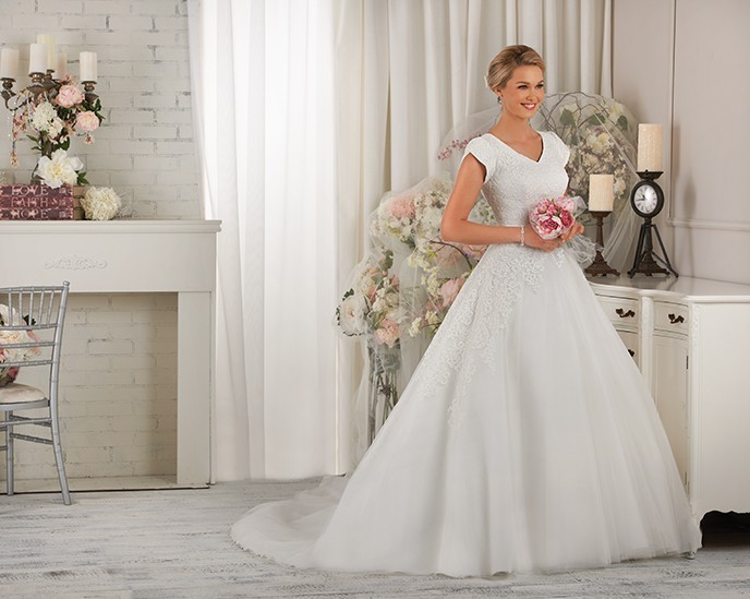 A wedding dress for a wide shouldered bride
