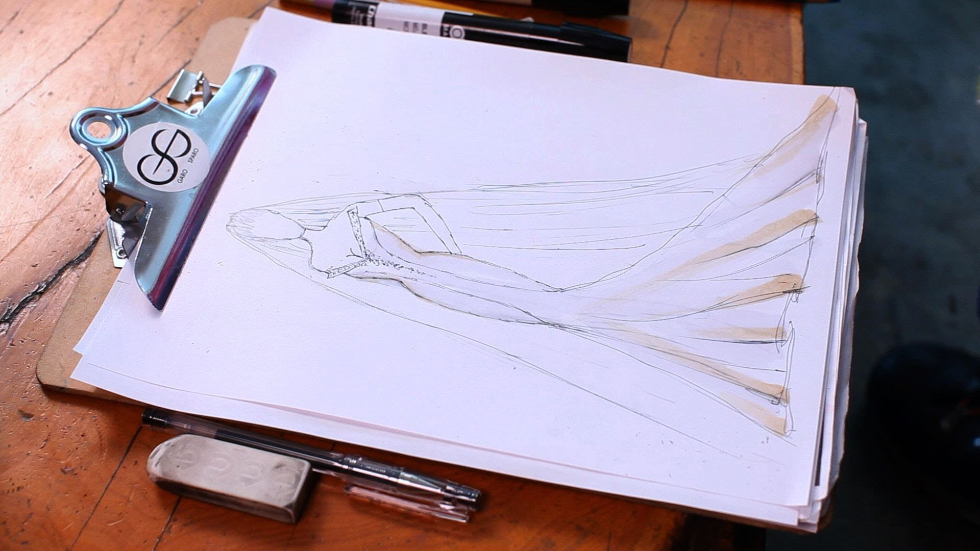 Drawing the sketch of the wedding gown