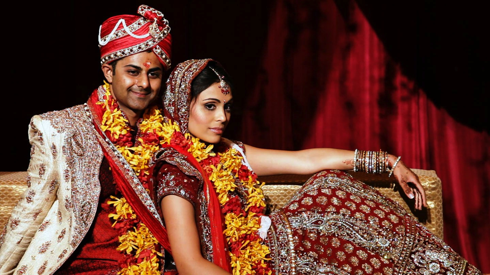Traditional Indian wedding dresses of bride and groom