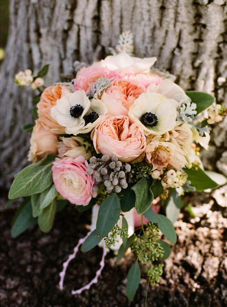Wedding bouquet with anemones and garden roses