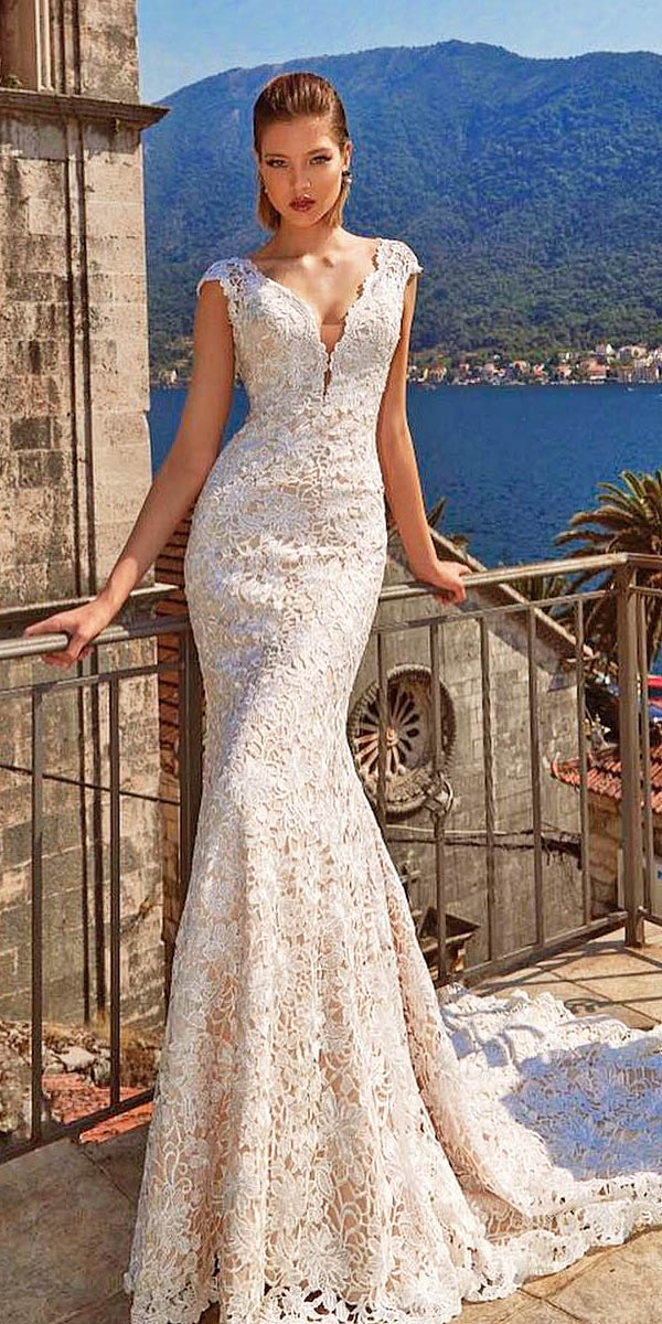 V-neck lace wedding dress with cap sleeves