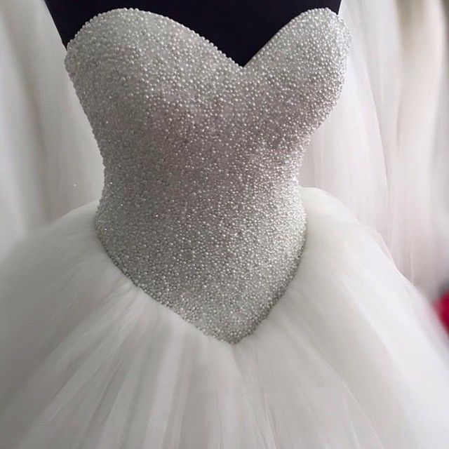 how to embellish simple wedding dresses the best