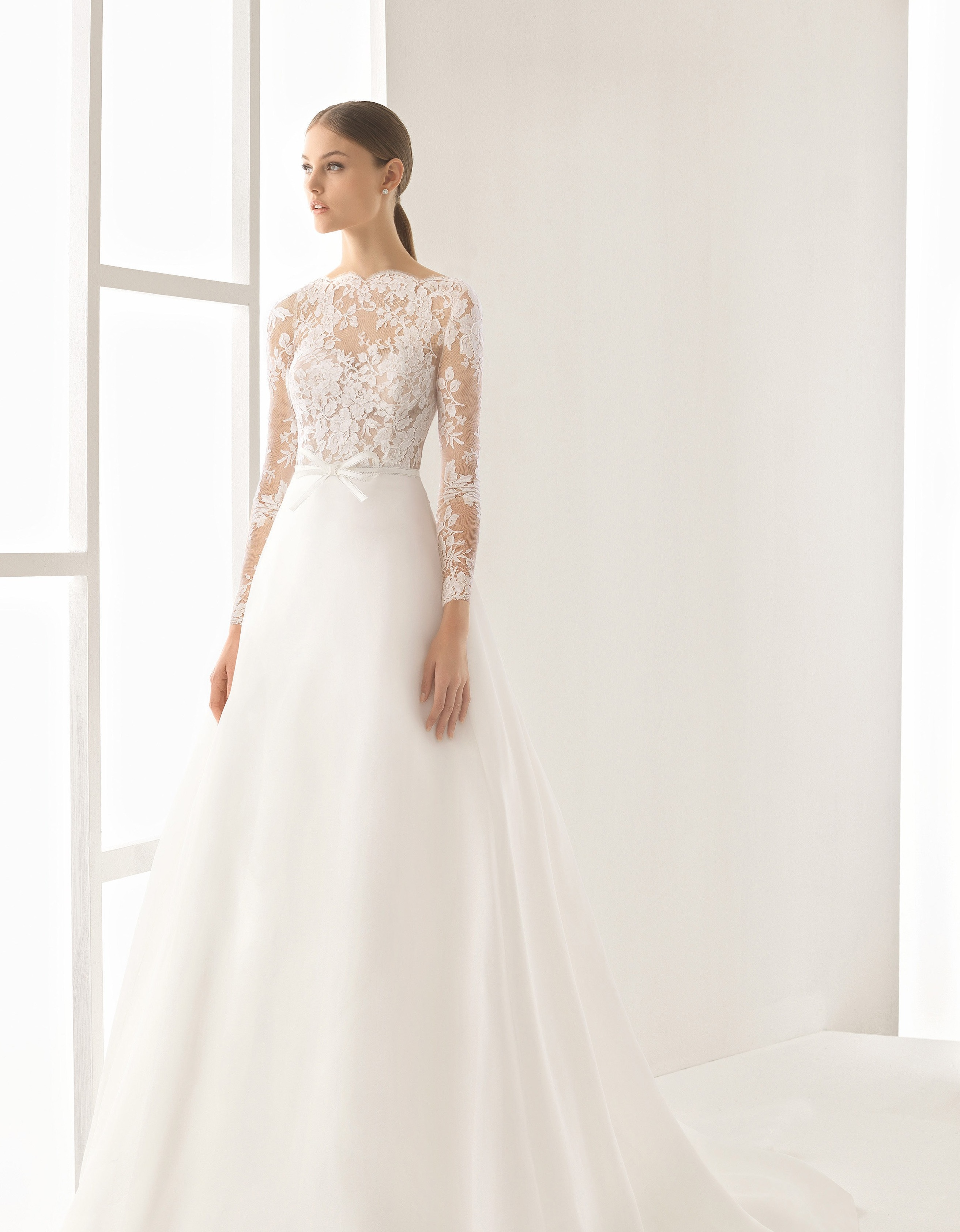 A-line wedding dress with illusion bodice and long sleeves