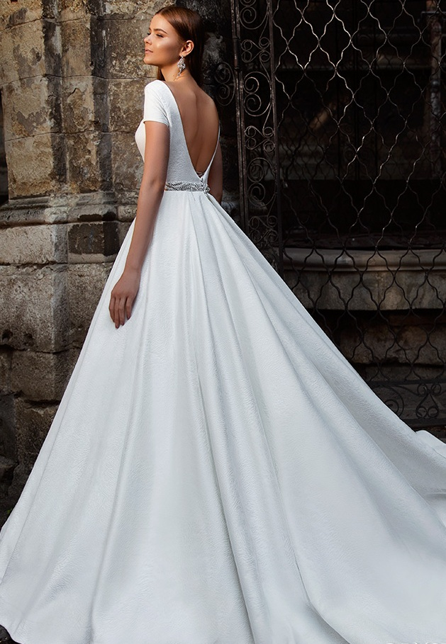 Satin wedding dress with short sleeve and open back