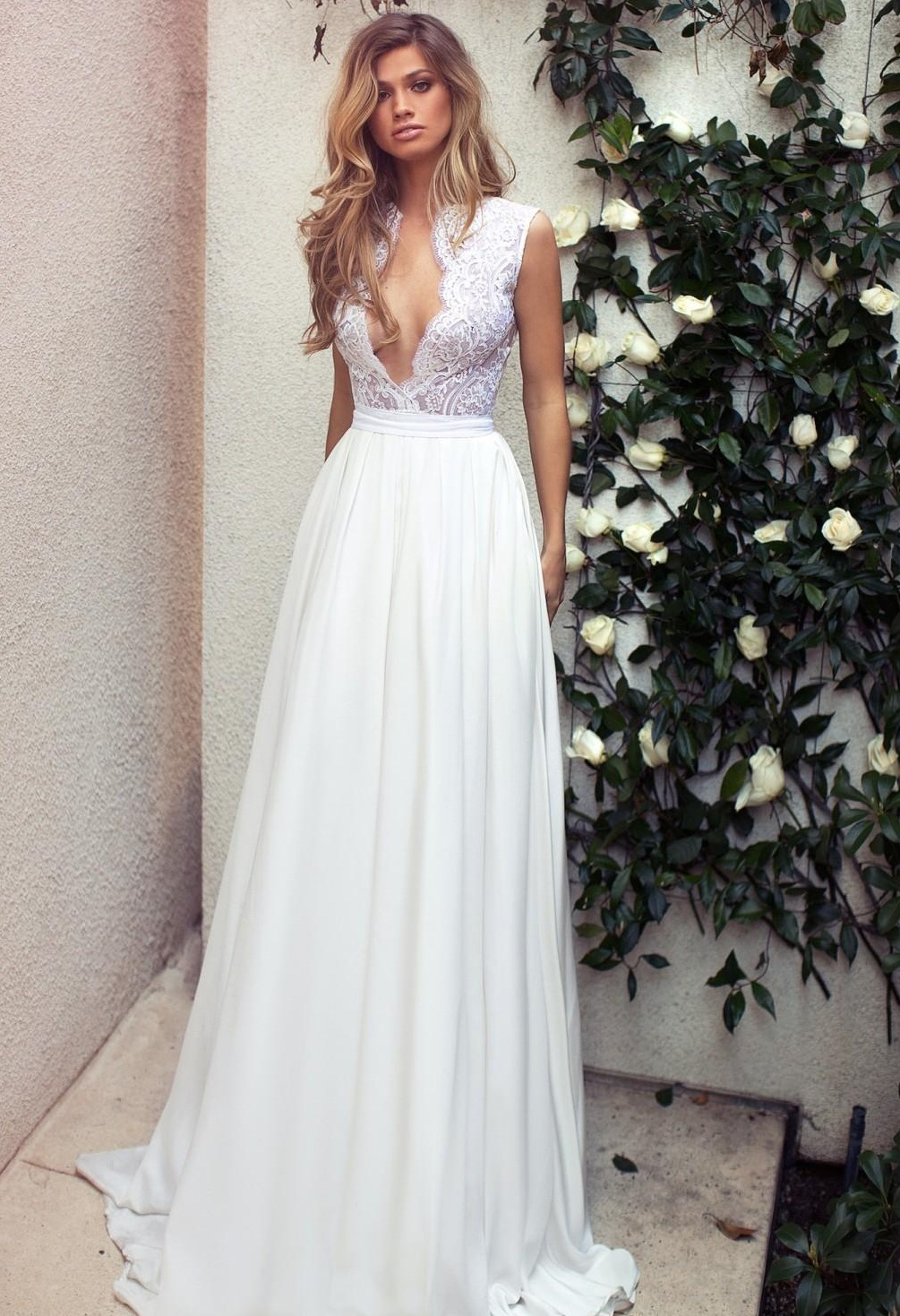 Plunging neckline beach wedding dress
