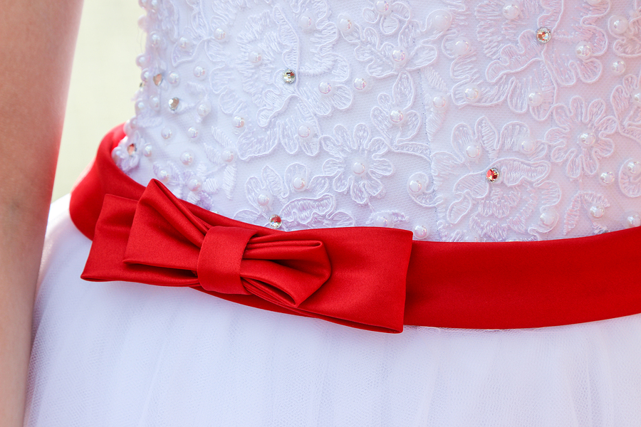 White wedding dress with red accent