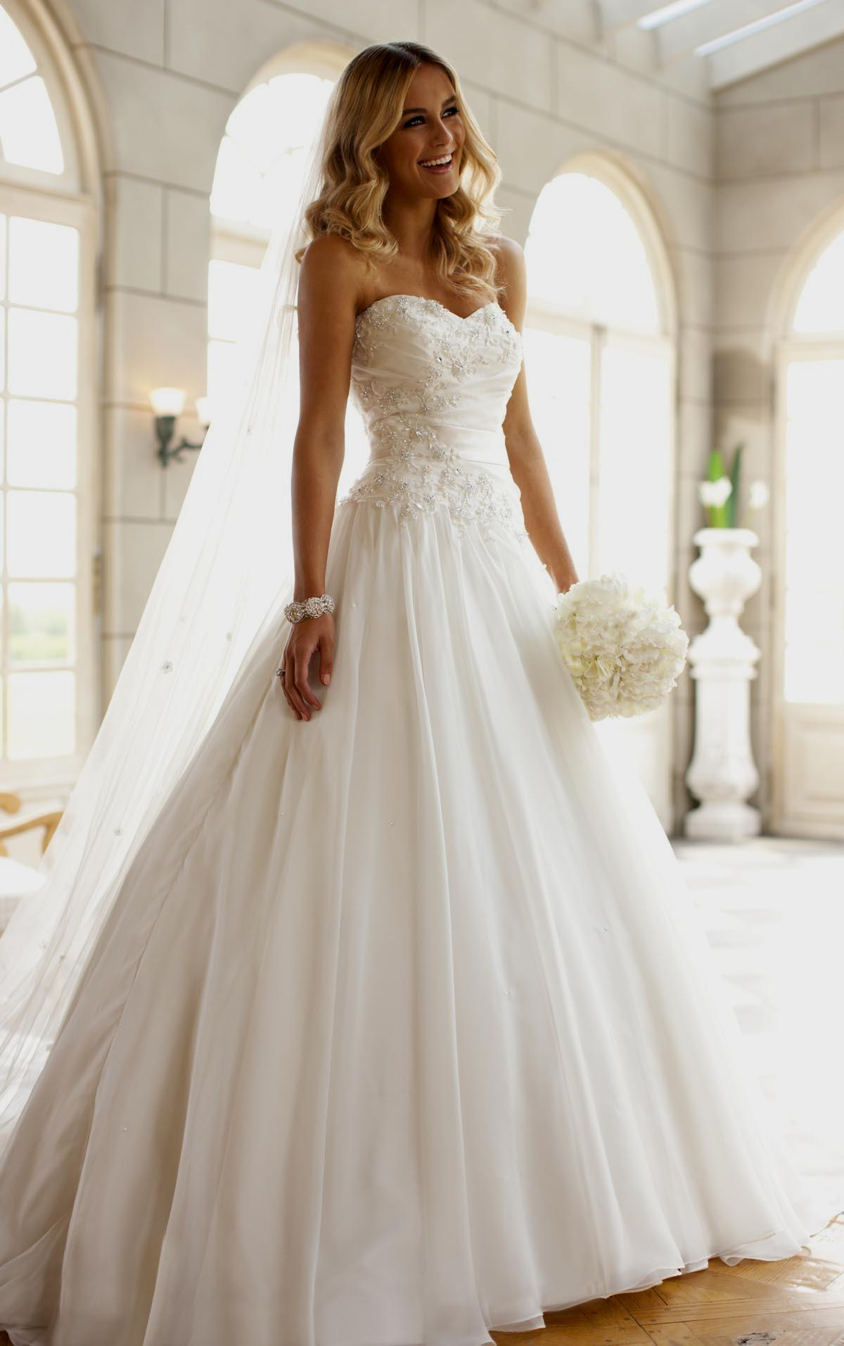 Strapless wedding dress with asymmetrical draperies