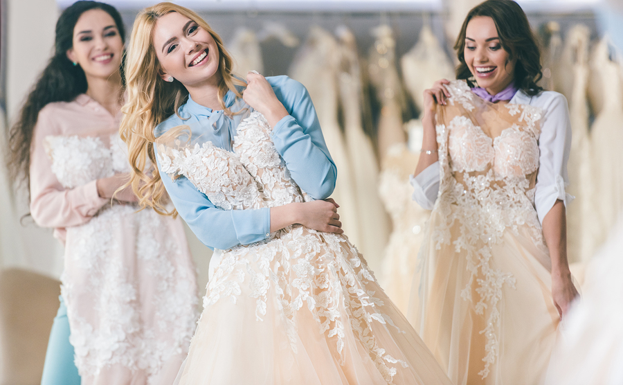 Girls choosing wedding dresses
