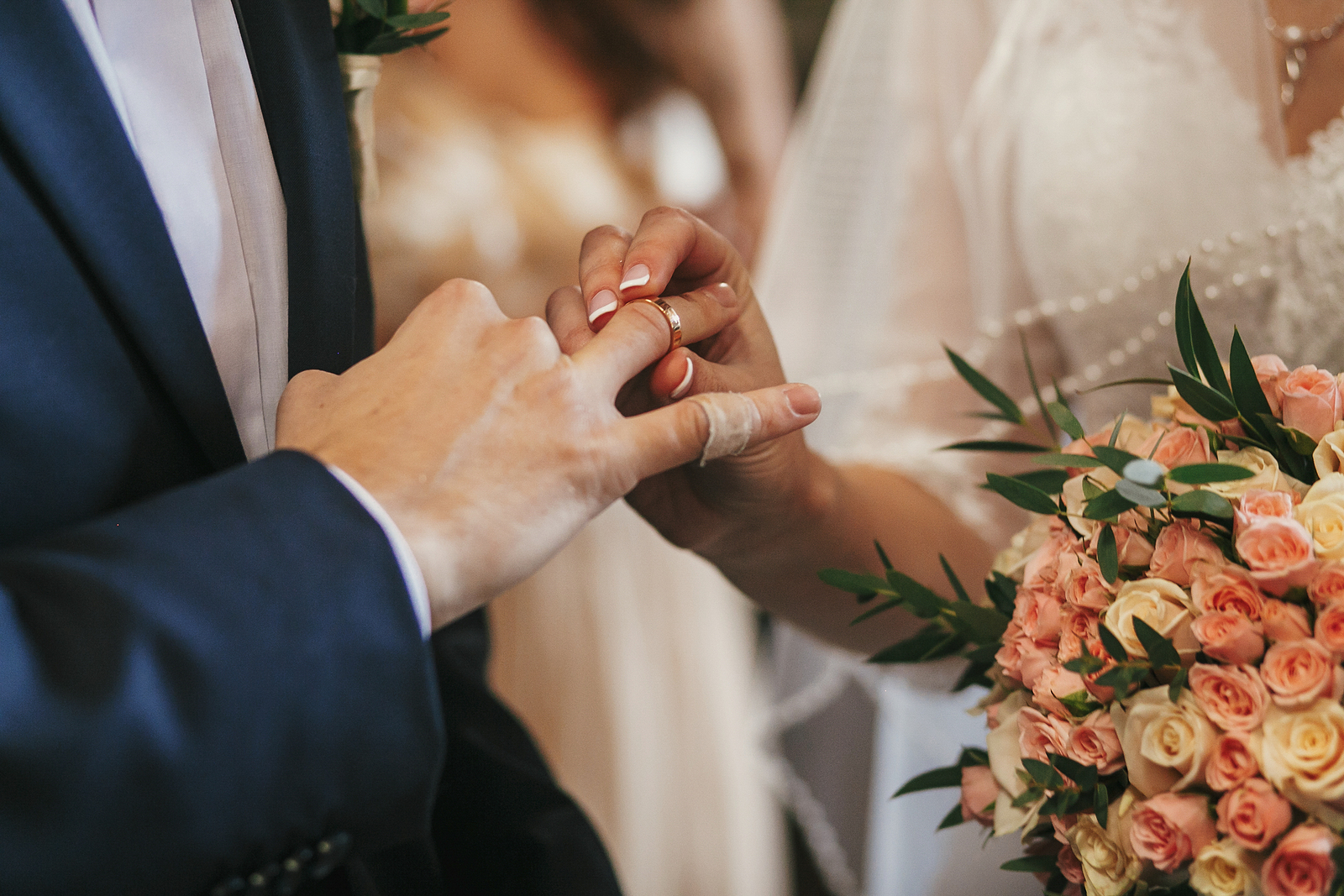Bride And Groom Hands Exchanging Wedding Rings
