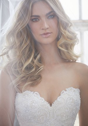 Romantic curls and strapless neckline
