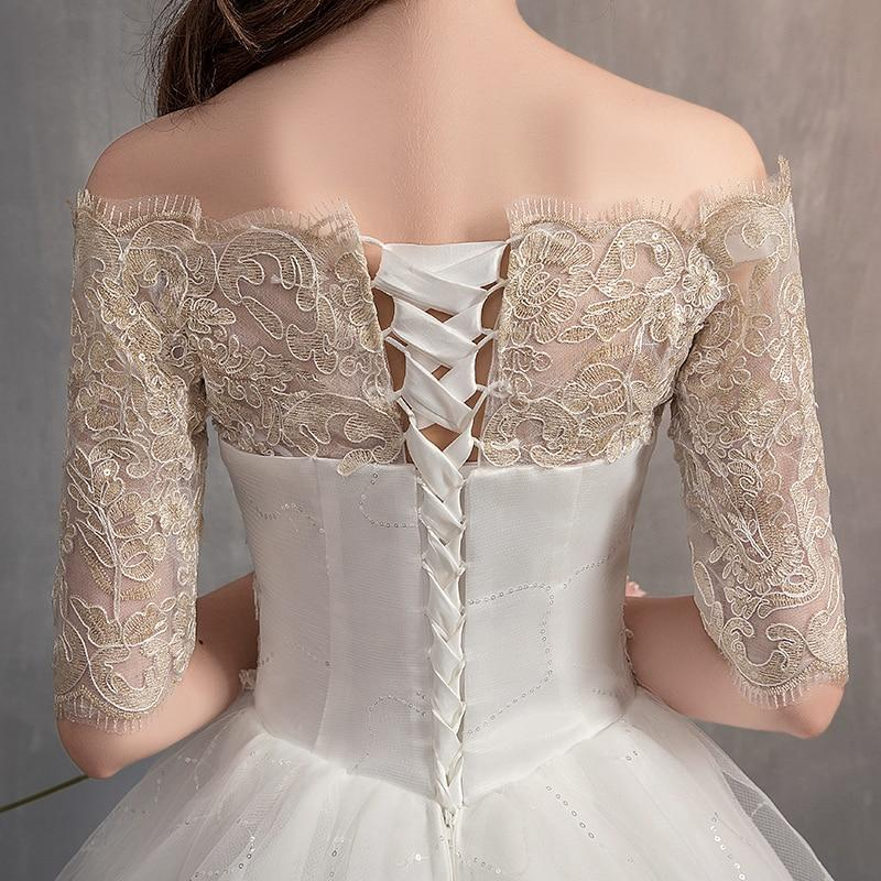 Dress features a lace up bodice