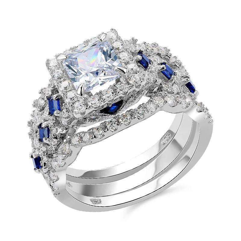 Ring with white and blue rhinestones