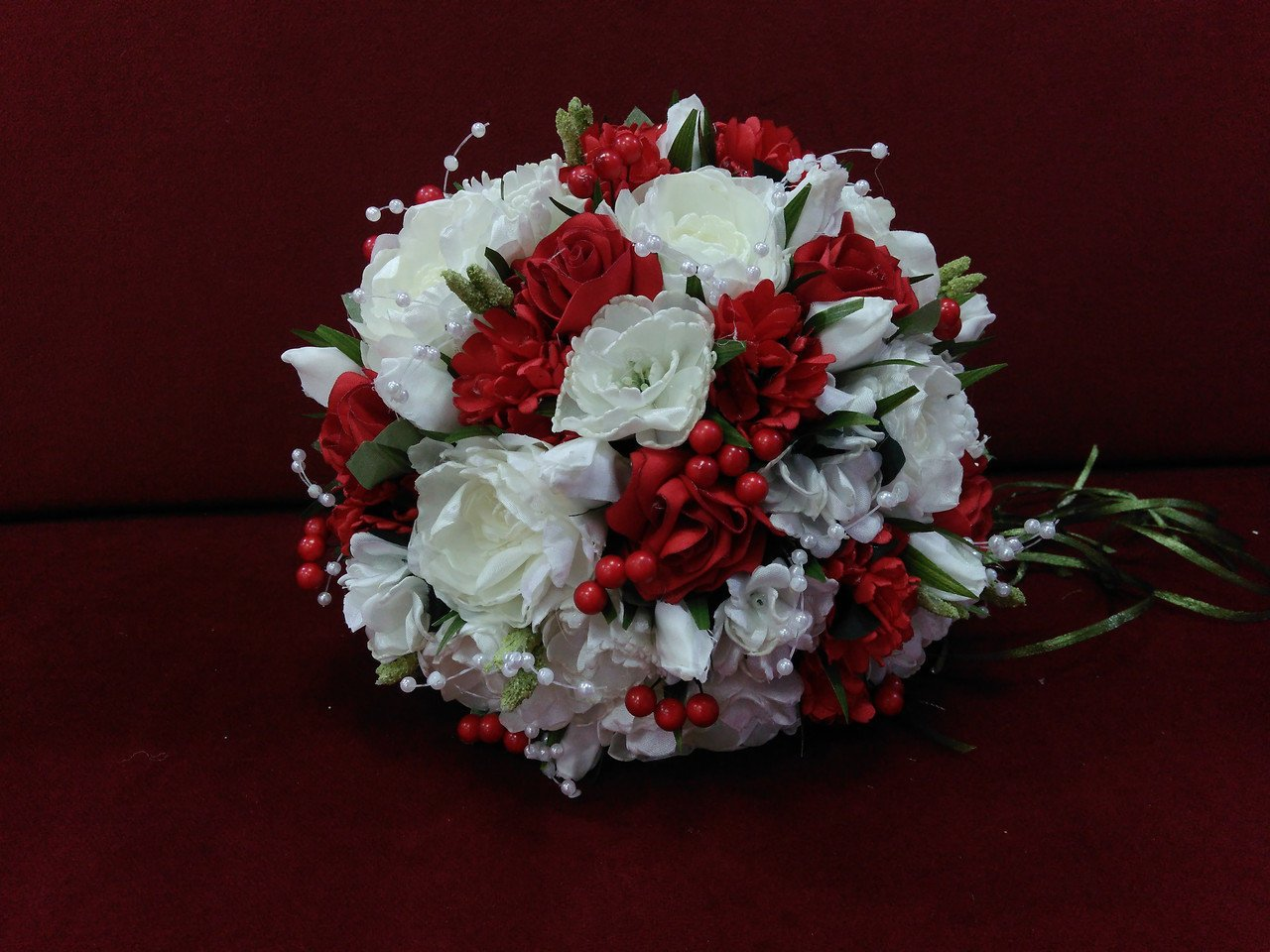 Ivory and red wedding bouquet