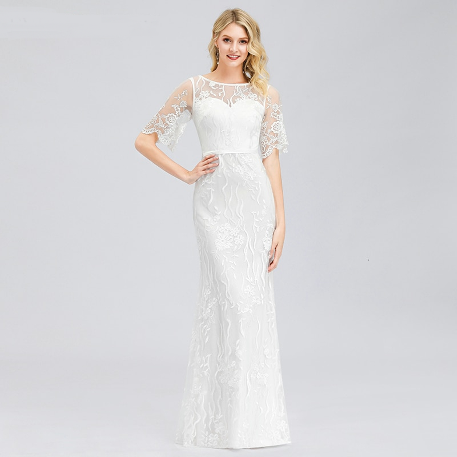 Mermaid wedding gown with flutter sleeves