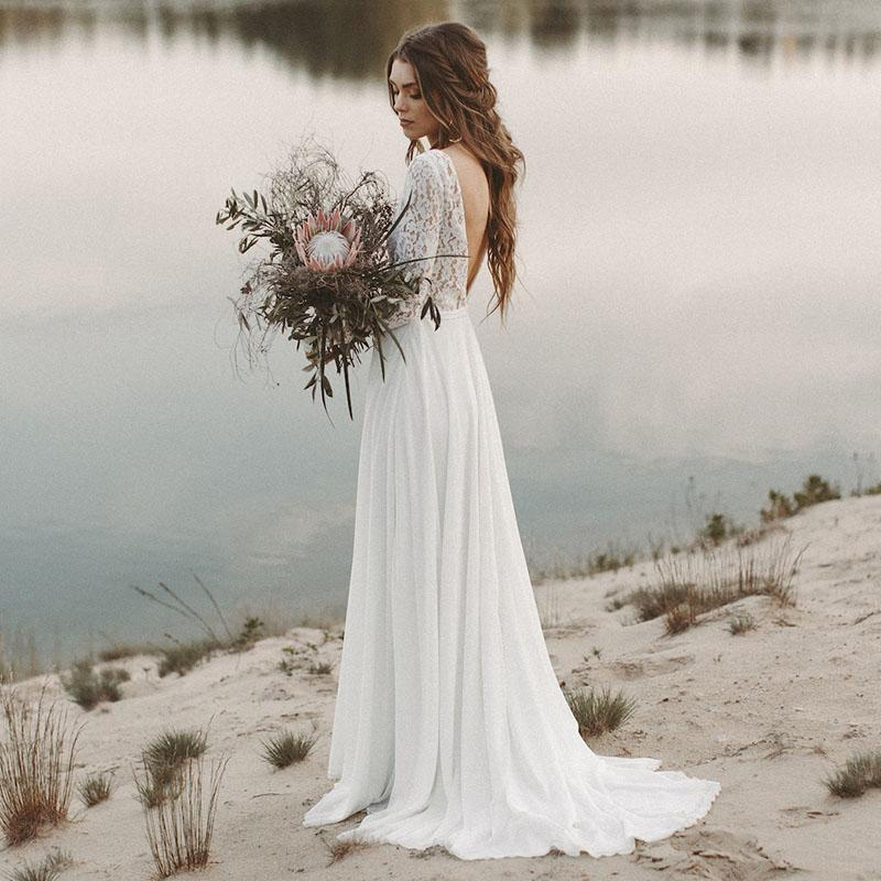 Open back wedding-dress with sleeves