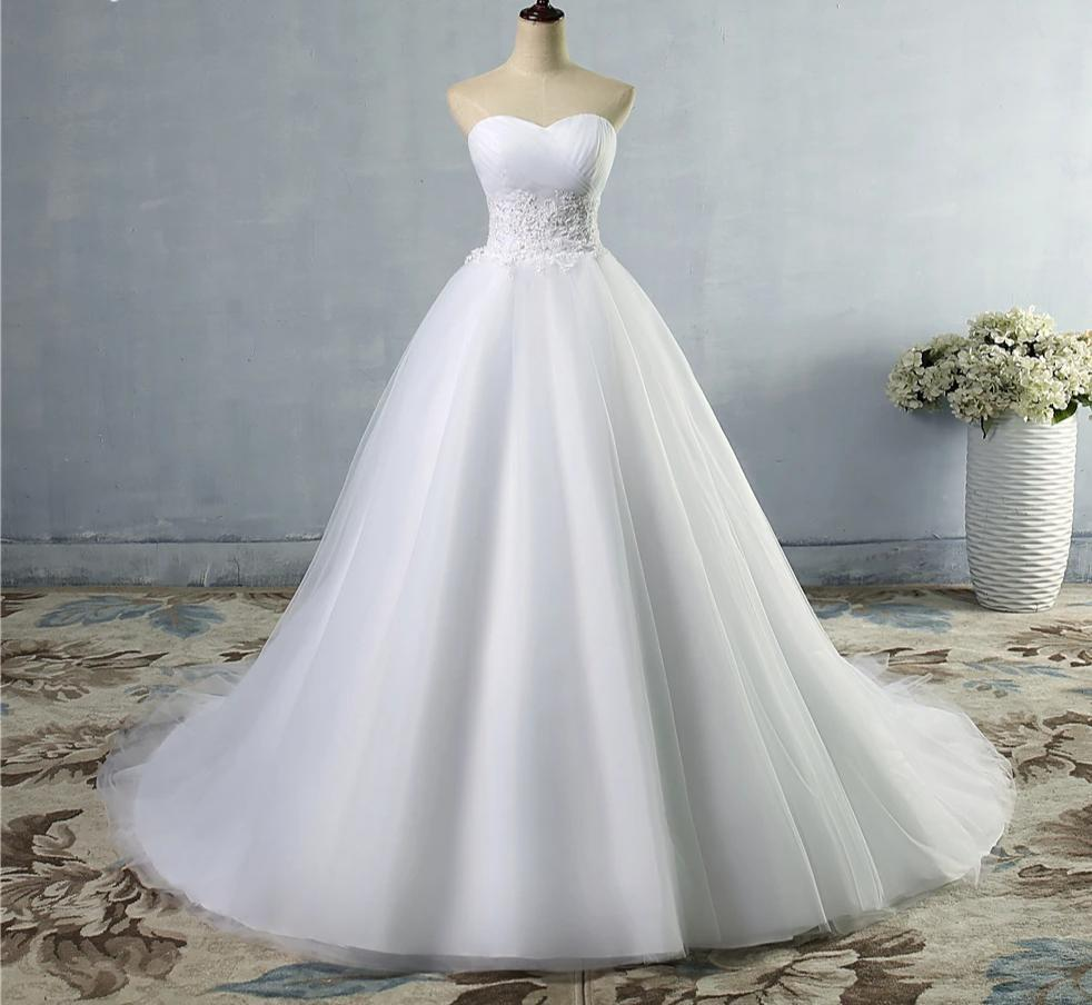 Wedding dress with lace waist accent