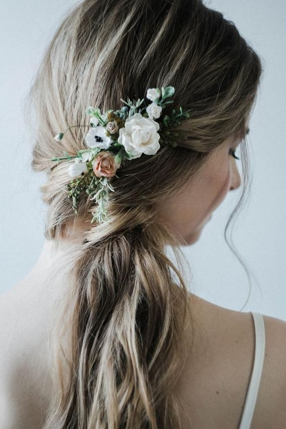 Side swept ponytail with flowers