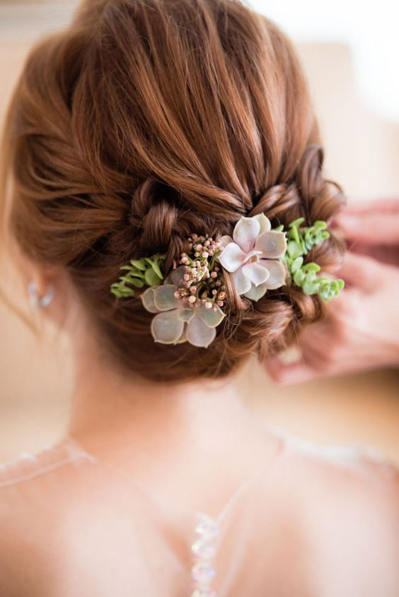 Bridal updo with delicate flowers