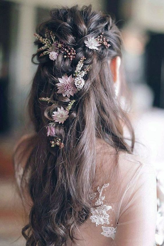 Flowers interweaved into wedding hairstyle