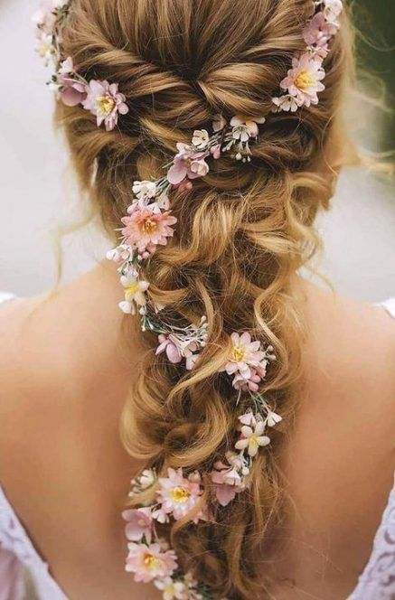 Flowers interweaved into a braid