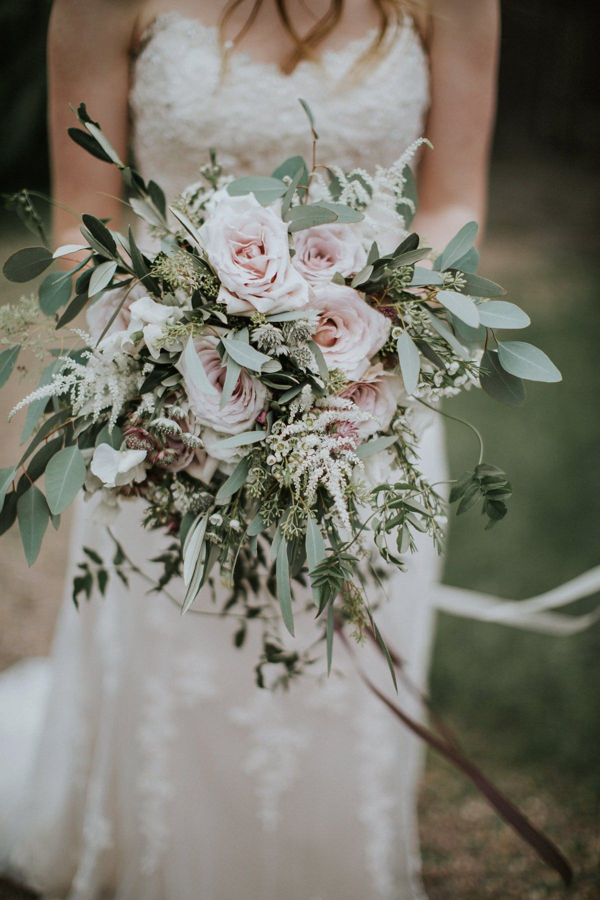 Rustic wedding bouquet with pink roses
