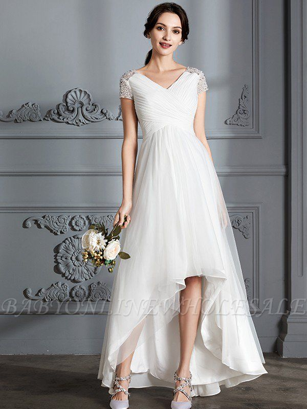 High low wedding dress with beaded sleeves